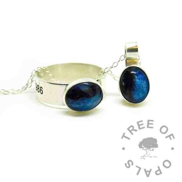 Hair jewellery engraved ring, 6mm shiny band engraved outside with Arial font and heart emoji. Aegean blue resin sparkle mix with short dark hair, matching mystery piece necklace