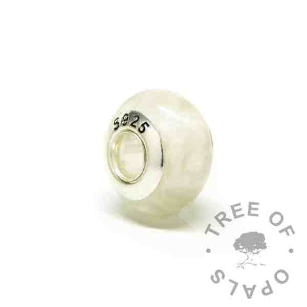 breastmilk bead back with S925 stamping. Full solid sterling silver core (not glue-in inserts)