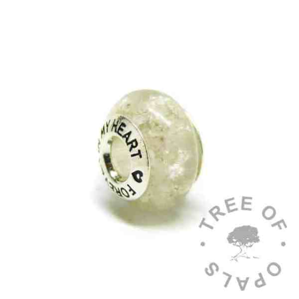 breastmilk bead with unicorn white resin sparkle mix and umbilical cord. Forever in my heart core
