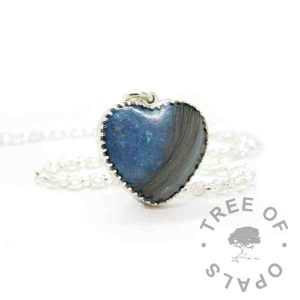 New style heart necklace setting with scalloped edge. Aegean blue resin sparkle mix, lock of hair, shown with a medium classic chain upgrade (mockup of new setting)