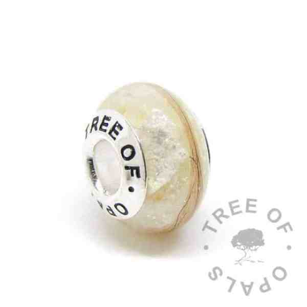 golden pearly sparkle mix breastmilk bead with first curl. Tree of Opals core