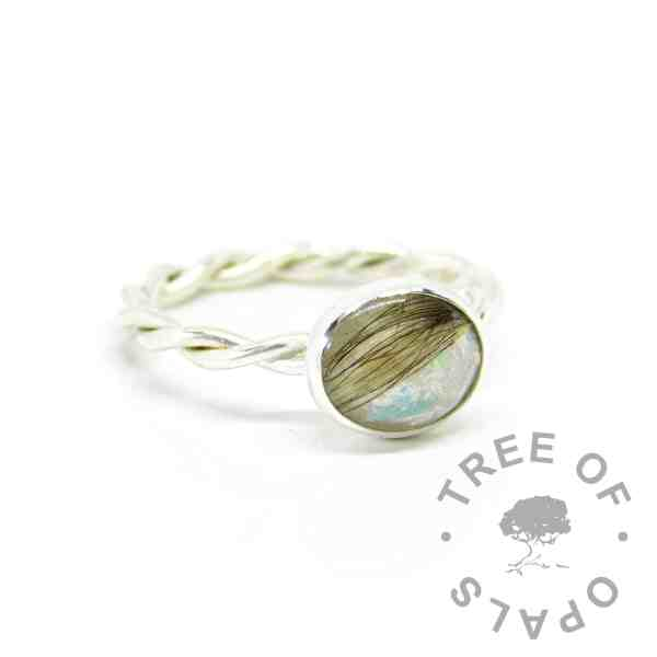 Breastmilk and pearly blue resin sparkle mix, on a twisted wire band (breastmilk mockup)