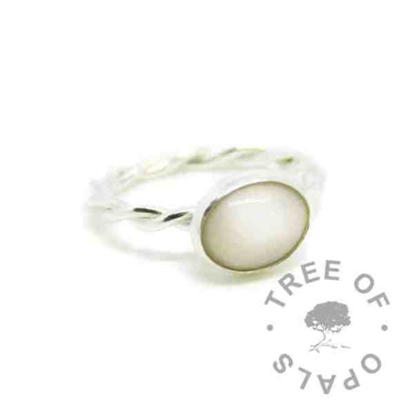 silver breastmilk ring, 10x8mm setting with hair and classic breastmilk. Twisted 2.4mm band, 935 anti-tarnish silver
