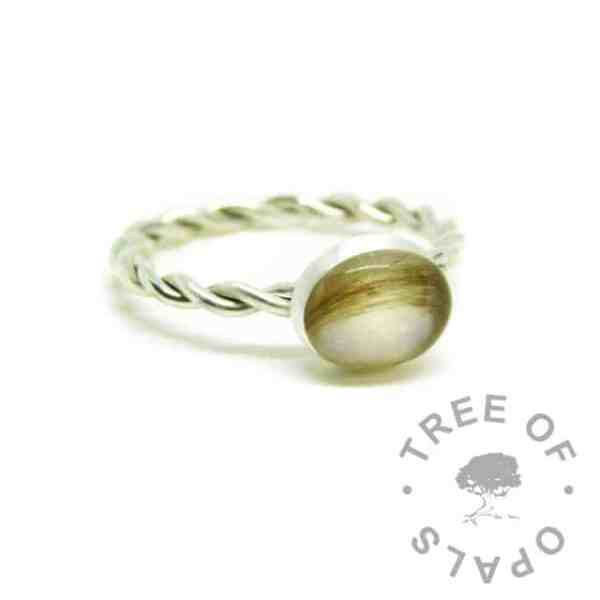 silver breastmilk ring, 10x8mm setting with hair and breastmilk. Twisted 2.4mm band, 935 anti-tarnish silver