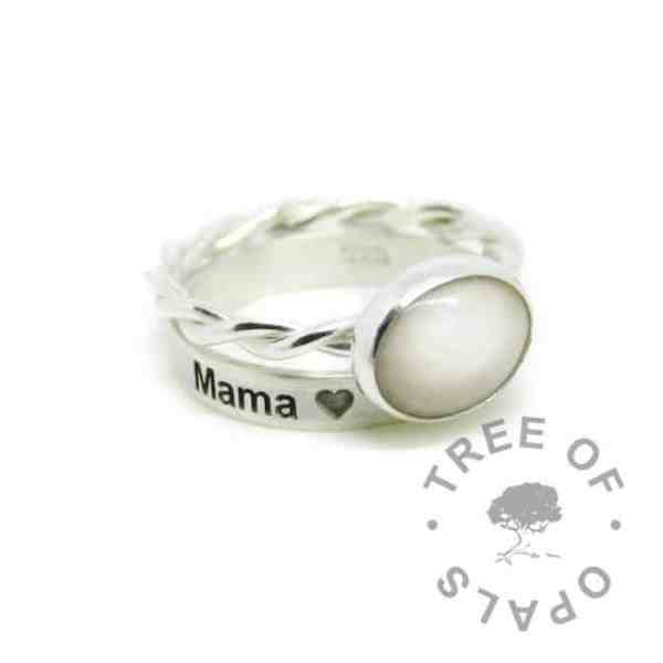 silver breastmilk ring, 10x8mm setting with hair and classic breastmilk. Twisted 2.4mm band, 935 anti-tarnish silver. Shown with an engraved stacking band