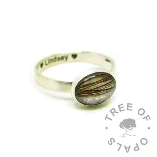 silver breastmilk ring, 10x8mm setting with hair and breastmilk, unicorn white resin sparkle mix. 3mm brushed band, 935 anti-tarnish silver, engraved on the inside in Arial font with heart emojis