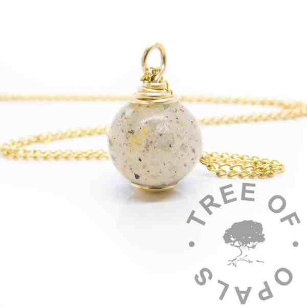 Solid 9ct gold breastmilk cord orb, breastmilk and two babies' umbilical cords, platinum leaf for 18 month breastfeeding awards (platinum boobies). No colour or shimmer added, 11mm sphere with hand wire wrapped setting shown with chain upgrade