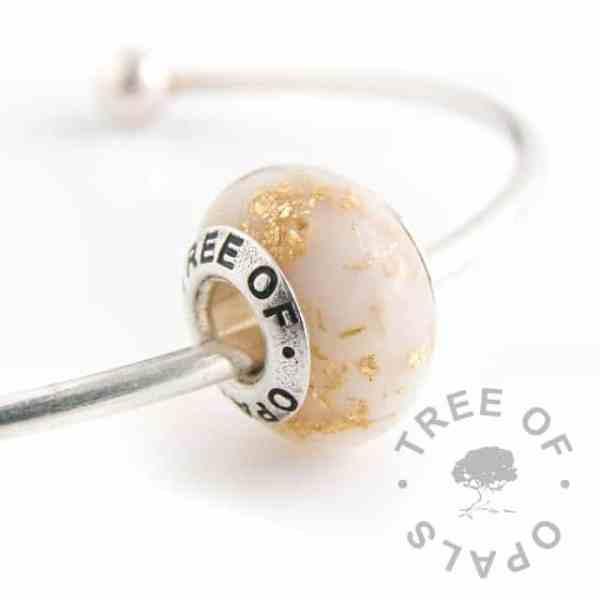 breastmilk bead with gold leaf, golden boobies (twelve month breastfeeding award). Tree of Opals core