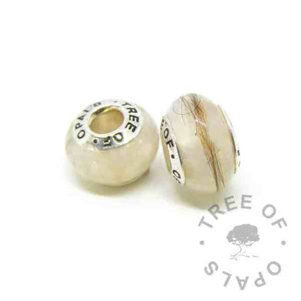 breastmilk bead duo (two beads) with first curl and golden pearly breastmilk sparkle mix. Tree of Opals core