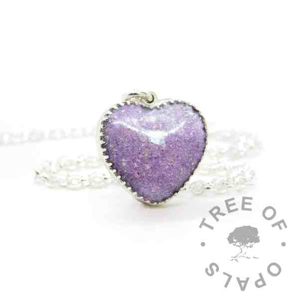 New style heart necklace setting with scalloped edge. Orchid purple resin sparkle mix, cremation ashes, shown with a medium classic chain upgrade (mockup of new setting)