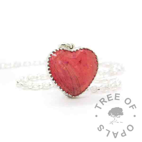 "New style heart necklace setting with scalloped edge. Dragon's blood red resin sparkle mix, lock of hair, shown with a medium classic chain upgrade (mockup of new setting). Remember that ""white hair"" is often translucent in resin!"