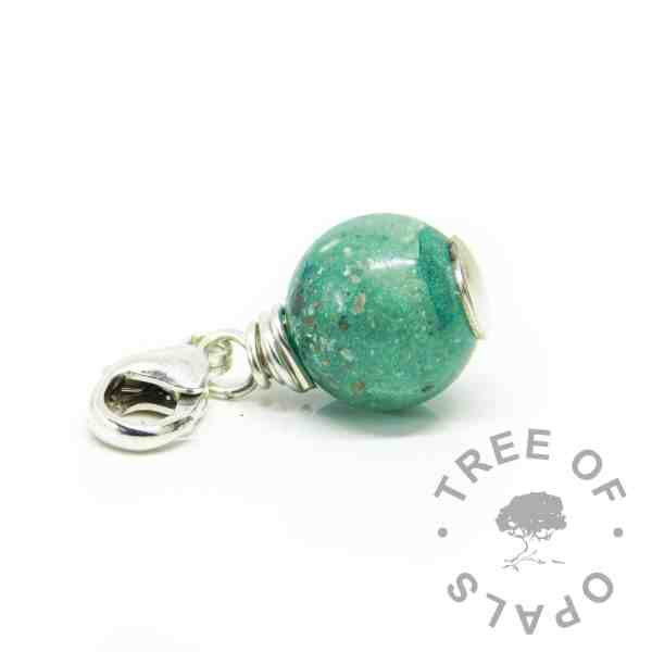 ashes orb teal. Mermaid teal resin sparkle mix with cremation ashes, solid silver wire wrapped setting with lobster clasp dangle charm setting