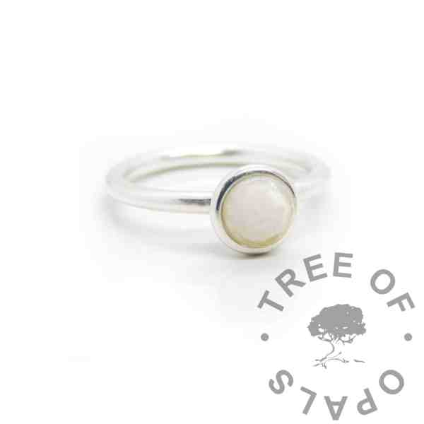 Ayla Breastmilk Ring Classic breastmilk Ayla Solitaire Ring, preserved dried breastmilk in resin made into a cabochon (stone) and set into the ring with glue. Cast Argentium 935 anti-tarnish silver (higher purity than sterling)