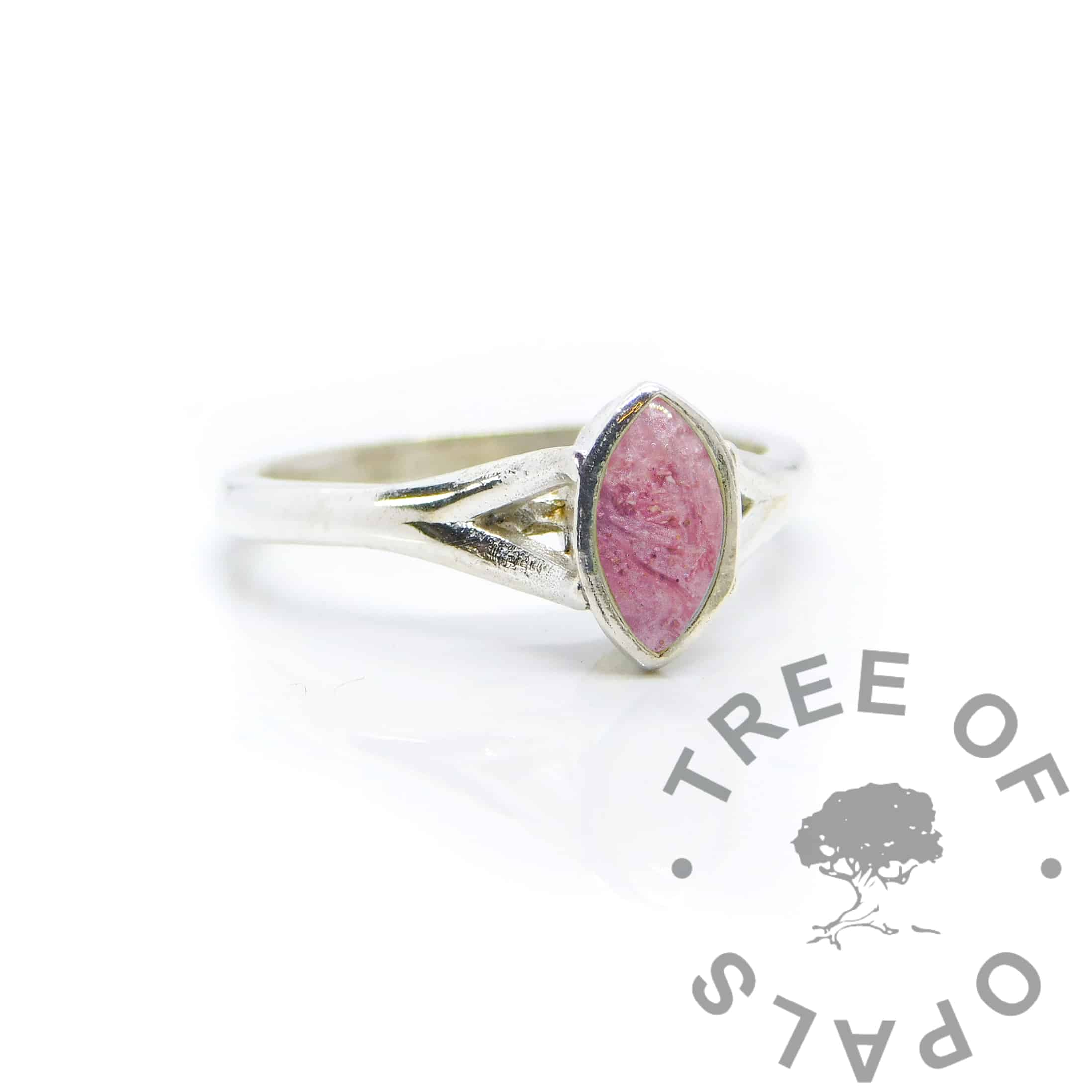 Hannah Cremation Ashes Ring Ashes Hannah Marquise ring, fairy pink resin sparkle mix, solid 935 purity Argentium silver, cast by hand in Scotland. Split shank band, engravable on the inside. 8x4mm marquise setting for filling or fitting a cabochon