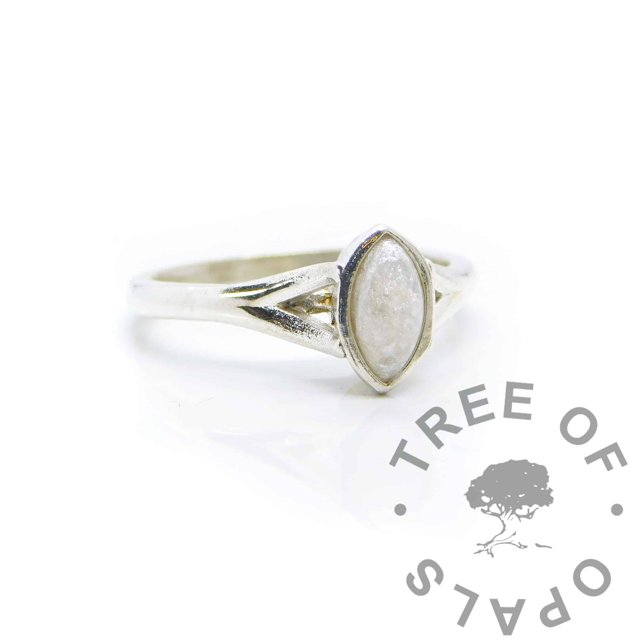 Breastmilk Hannah ring with unicorn white resin sparkle mix, solid 935 purity Argentium silver, cast by hand in Scotland. Split shank band, engravable on the inside. 8x4mm marquise setting for filling or fitting a cabochon
