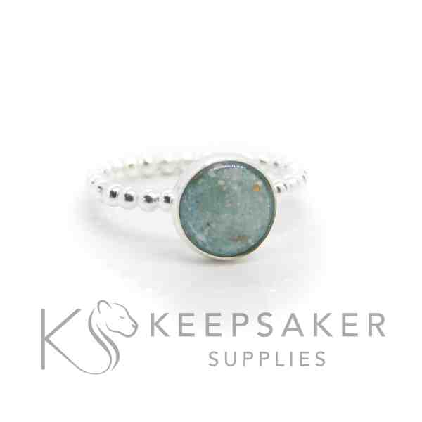 aqua ashes bubble ring, cremation ashes and angelic aqua resin sparkle mix. Bubble band ring and 8mm round cabochon