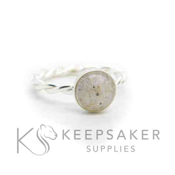 classic ashes twist ring, cremation ashes and clear resin (no sparkle mix). Twisted band ring and 8mm round cabochon