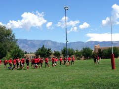 Rugby under the deep blue skies.