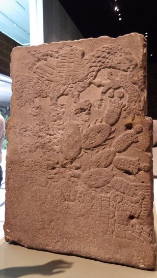 A stone altar with Opuntia carved into the rear.
