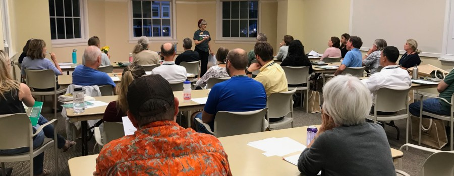 Nora Palmatier, standing, describes training to become a volunteer Tree Steward of Arlington and Alexandria to a roomful of new and returning interns.