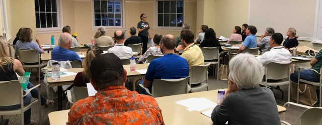 Nora Palmatier, standing, describes training to become a volunteer Tree Steward of Arlington and Alexandria to a roomful of new and returning interns. Photo by Tree Steward Jo Allen