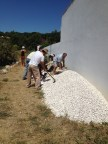 filling the sacs with gravel