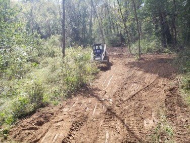 using a bobcat for earthworks, terracing for campsites and trees crops