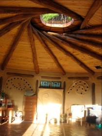 Reciprocal Roof Earthen Roundhouse at an Eco-village in New Zealand