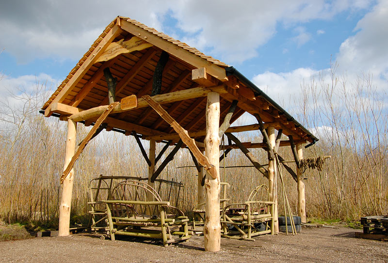 roundwood construction with roundwood furniture http://www.naturalbuildingspecialists.co.uk/wildlife-trust-outdoor-classroom.html