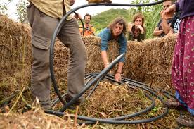Unwinding tubing for compost shower, 2011, encircled by strawbales Portugal