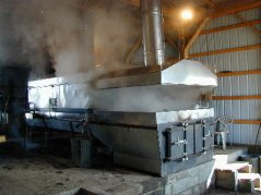 inside the sugar shack boiling down syrup on a commercial scale