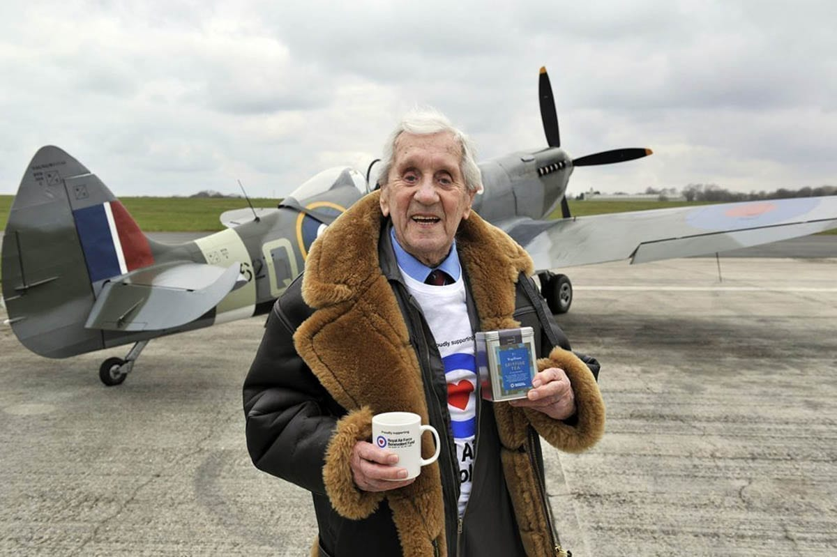 Squadron Leader, 96-year-old Allan Scott DFM Photographed holding a tin of Spitfire Tea