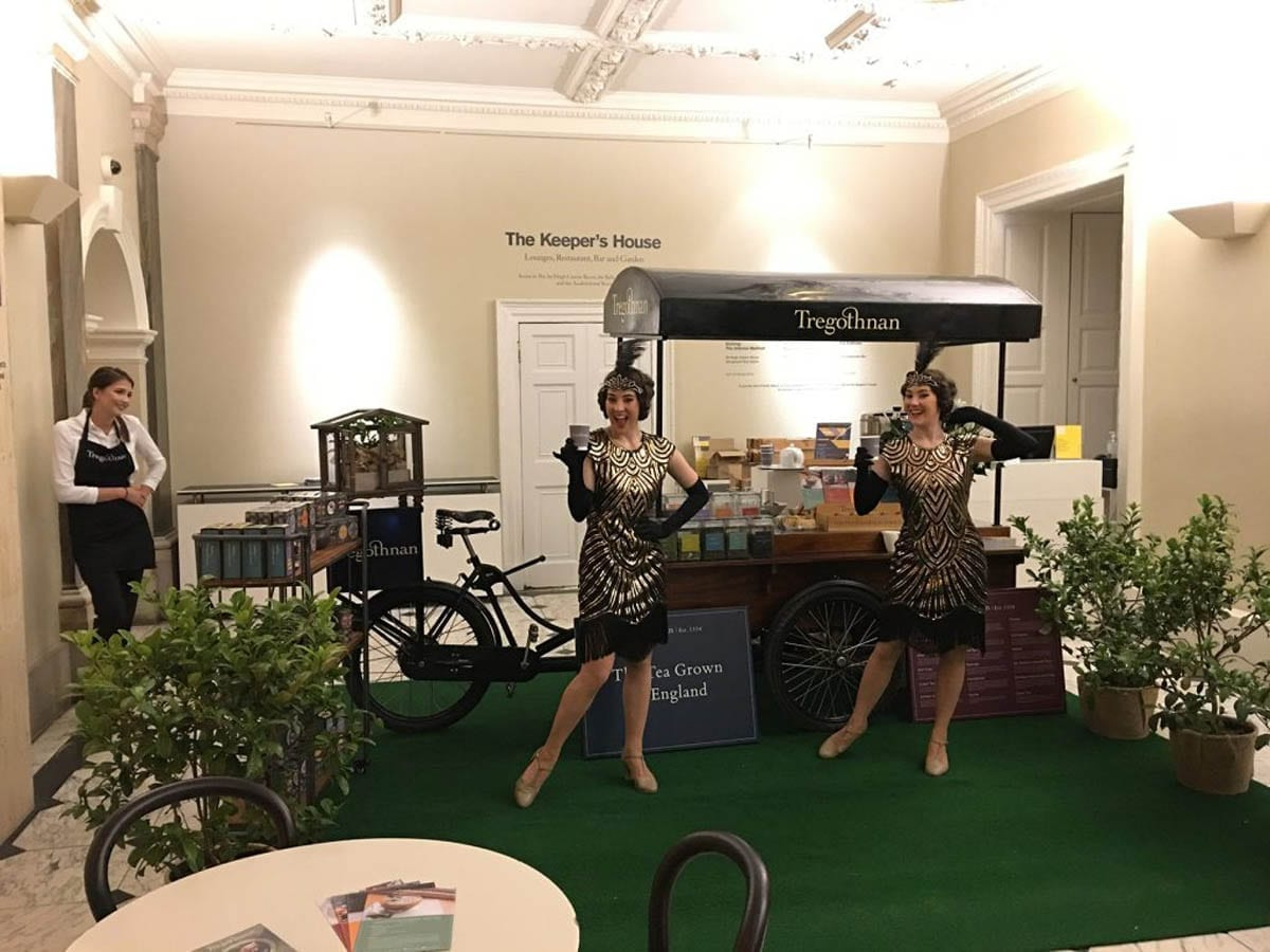 The Twin Swing duo wearing gold and black 1920s inspired dresses