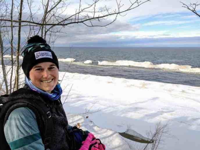 smiling girl overlooking lake