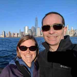 smiling couple with NYC skyline