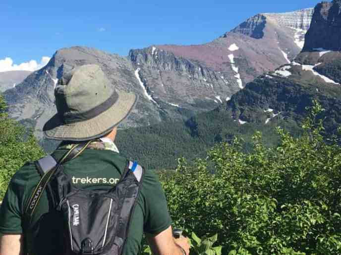 Profile of hiker with mountains