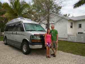 couple with campervan in driveway