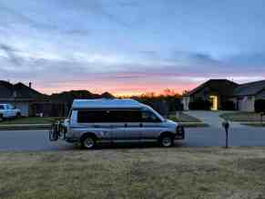 Class B RV van parked on neighborhood street