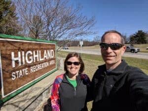 woman and man at state park sign