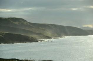 Impressive hills extending into the sea