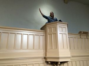 "Pulpit in the women's prison chapel, son Brian ""preaching the word"""