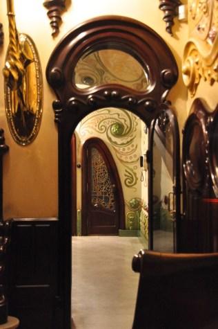 The foyer door leads to an interestingly shaped door