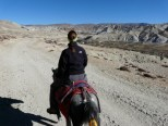 A tourist riding a mule in Mustang. It's a common mode of transportation here