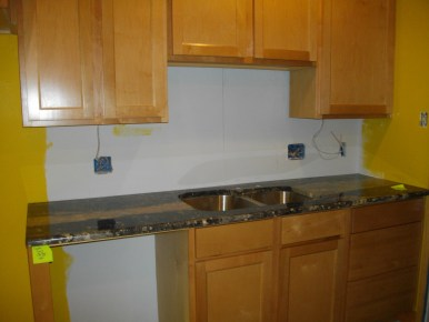 Sink, cabinets and dishwasher to be