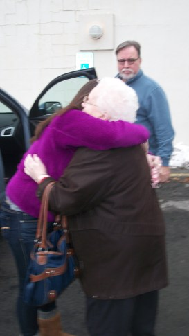 Hugging Oma goodbye. Uncle Bob in background