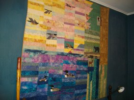 The quilt hangs on the wall of my sewing room which I transformed from Eli's bedroom when he was still home.