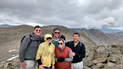 The 5 of us getting our 2015 Christmas card photo snapped by John Huber, with mountains in background.