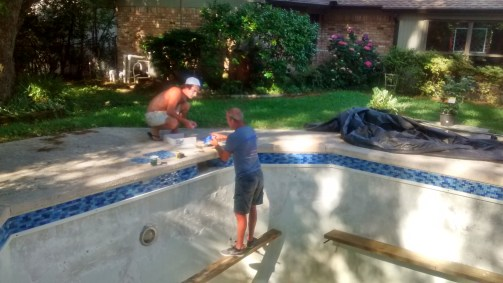 A beautiful Saturday in which Micah and Jeff are working to get the new tile in place.