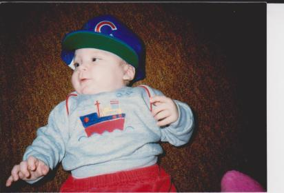 Steve creating a Cub fan at a young age. Winter 1988