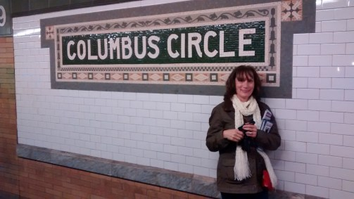 I love trains and subways. This is me at the subway exit for Central Park South. 8th Ave, Broadway and 59th Street.